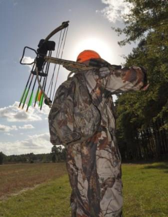 Hunter with crossbow slung over his shoulder