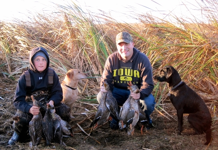 authors-grandson-and-son-with-ducks-448x308