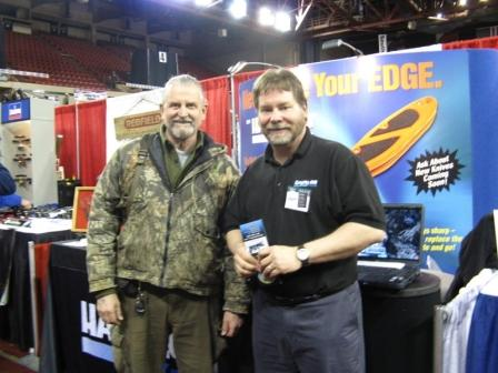 Division Sales Manager Paul Schwartz with Robert Gibson of the Kenai Peninsula Trappers Association
