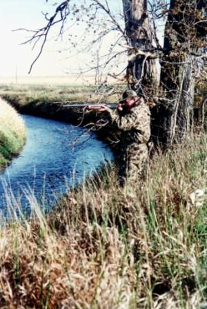 Duck hunting jump shooting across ditch