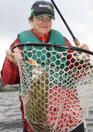 Angler with a fish caught in a net