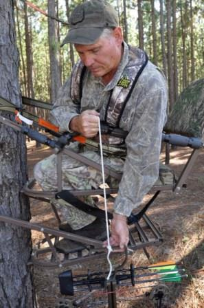 Hunter pulling his gear up safely to his treestand