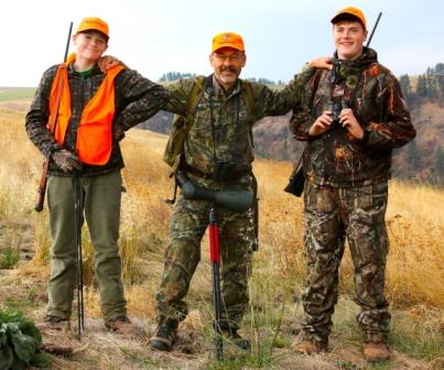 A veteran hunter with two young hunters in training