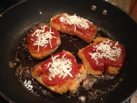 Cooked wild turkey parmesan with cheese on top