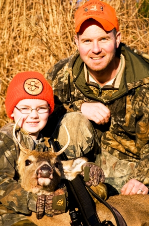 8yr-old-luke-trout-with-dad-297x448