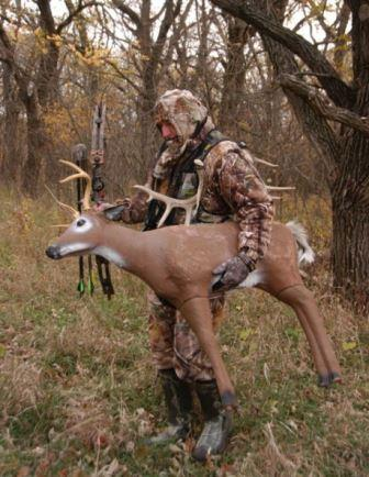 Hunter with deer decoy setting up