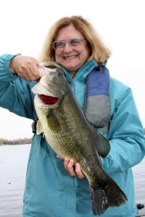 Angler with her trophy fall bass