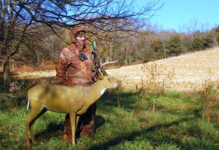 Bowhunter with deer decoy in the field