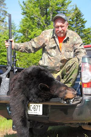 bill vaznis on a truck with a dead bear