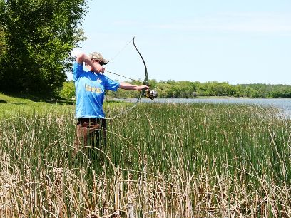 Bowfishing while wading can be as productive as shooting from a boat.