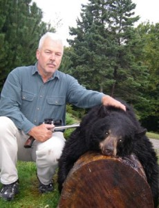 a hunter has the job of field dressing and skinning out his bear