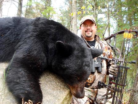 toby shaw with black bear trophy in michigan 448x336